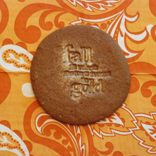 stamped cookie that has the image painted with pearl dust mixed with vanilla
