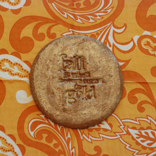 stamped cookie that was painted with pearl dust mixed with vanilla