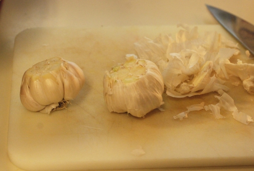 Garlic on the left is with the loose papery skins removed.
