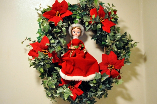 This little doll was a gift from one of my grandmother's friends, Mrs. Allie Mae Abraham when I was about 6 years old. This is the first time I have put her in a wreath. I kinda like her there.