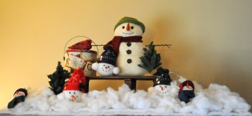 Snowman and friends on a sled.