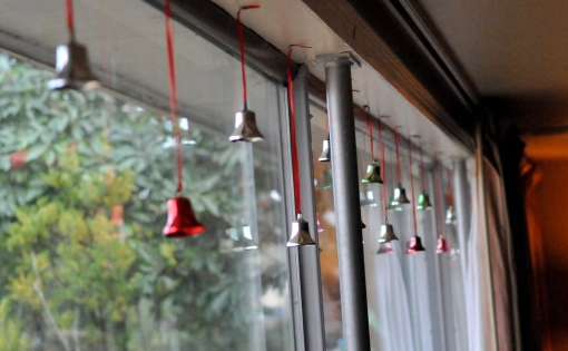 I like them hanging from these red ribbons. Maybe one year I'll try the lights.